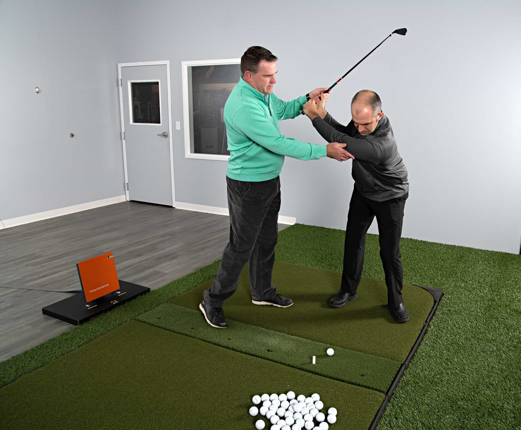 Golf Iron Swing Instruction - Instructor teaching a man